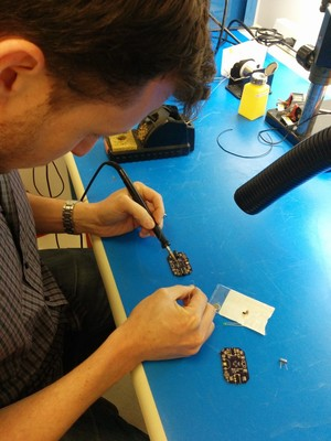 Eithan soldering the through hole components.